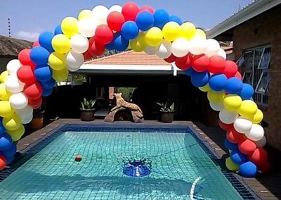 SPIRAL BALLOON ARCH OVER POOL