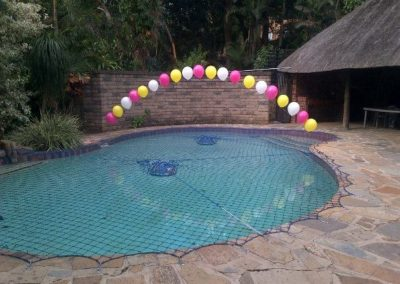 STRING OF PEARLS ARCH OVER POOL